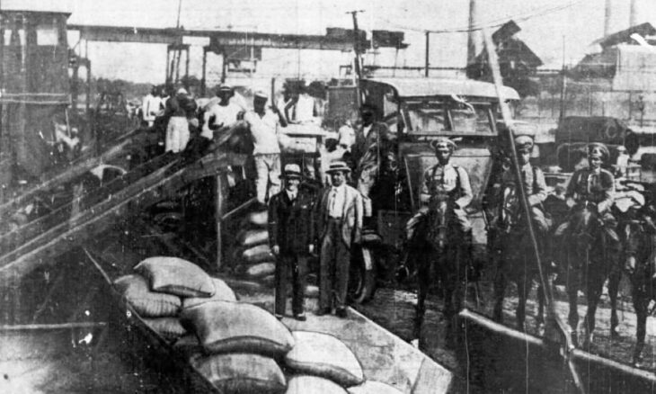 Excess coffee is loaded onto a steamer in Rio de Janeiro for dumping into the ocean.