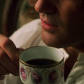 Antonio Banderas with coffee cup in Original Sin