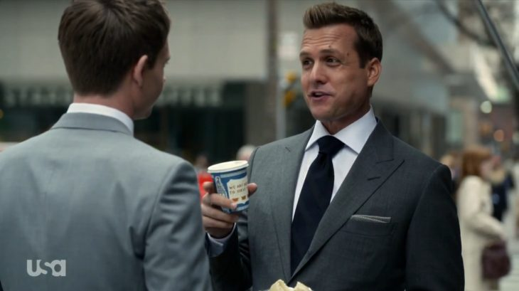 Gabriel Macht with an Anthora coffee cup on the TV show Suits.