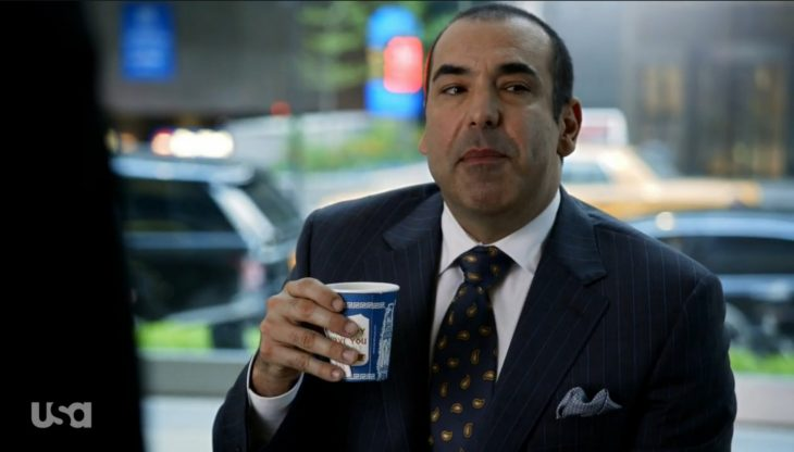Ron Hoffman drinks tea from an Anthora cup on the TV show Suits
