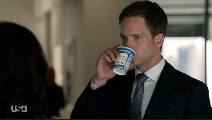 Patrick J. Adams drinks coffee from an Anthora cup on the TV show Suits