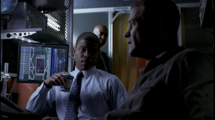 Sharif Atkins with an Anthora coffee cup in the TV show White Collar